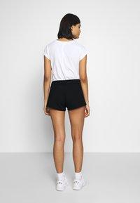 Calvin Klein Jeans - STRIPE LOGO JOGGING - Shorts - black - 2
