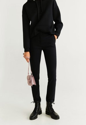 COLA - Trousers - black