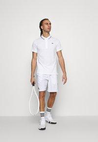 Lacoste Sport - DETAILED COLLAR - Poloshirt - white/black - 1