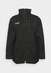 FTBLNXT CASUALS PARKA - Training jacket - black/fizzy orange
