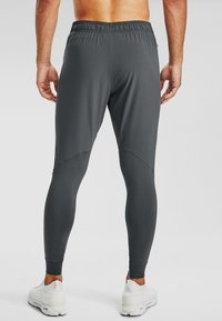 Under Armour - HYBRID - Tracksuit bottoms - pitch gray - 2