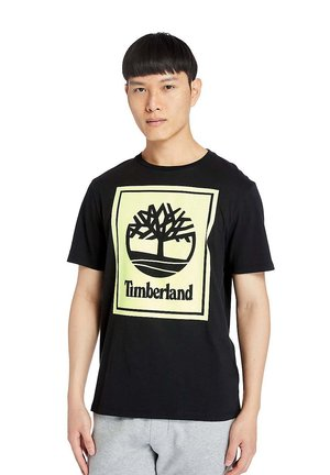 STACK - T-shirt med print - black/safety yellow