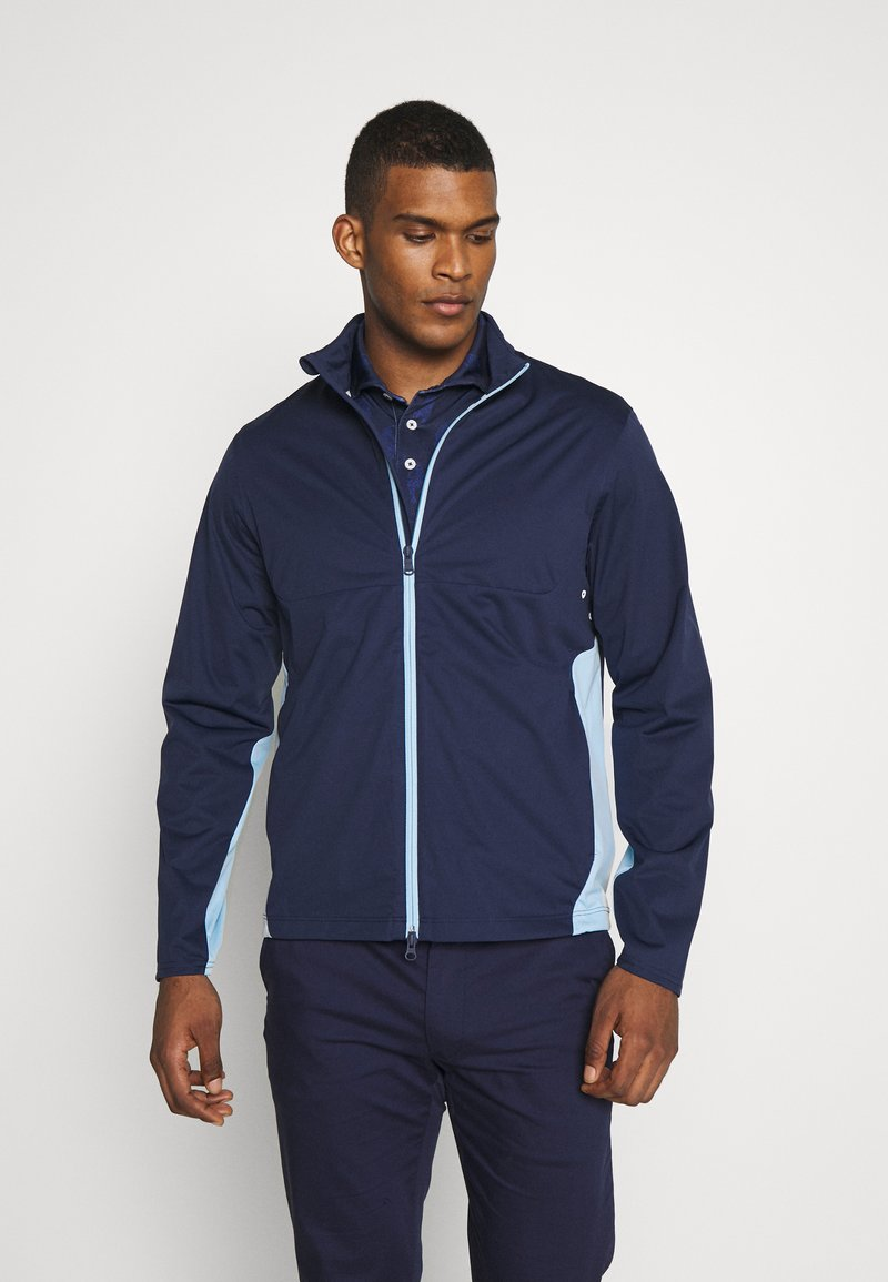 Polo Ralph Lauren Golf - STRATUS UNLINED JACKET - Vodotěsná bunda - french navy/powder blue
