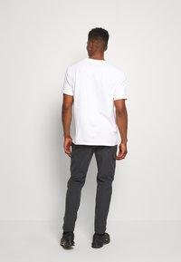 Nike Sportswear - FESTIVAL - Tracksuit bottoms - smoke grey/volt - 2