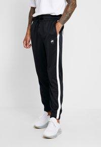 Nike Sportswear - AIR PANT - Träningsbyxor - black/white - 0