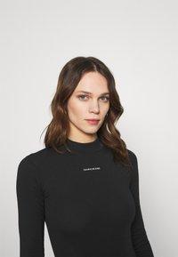 Calvin Klein Jeans - MICRO BRANDING - Long sleeved top - black - 3