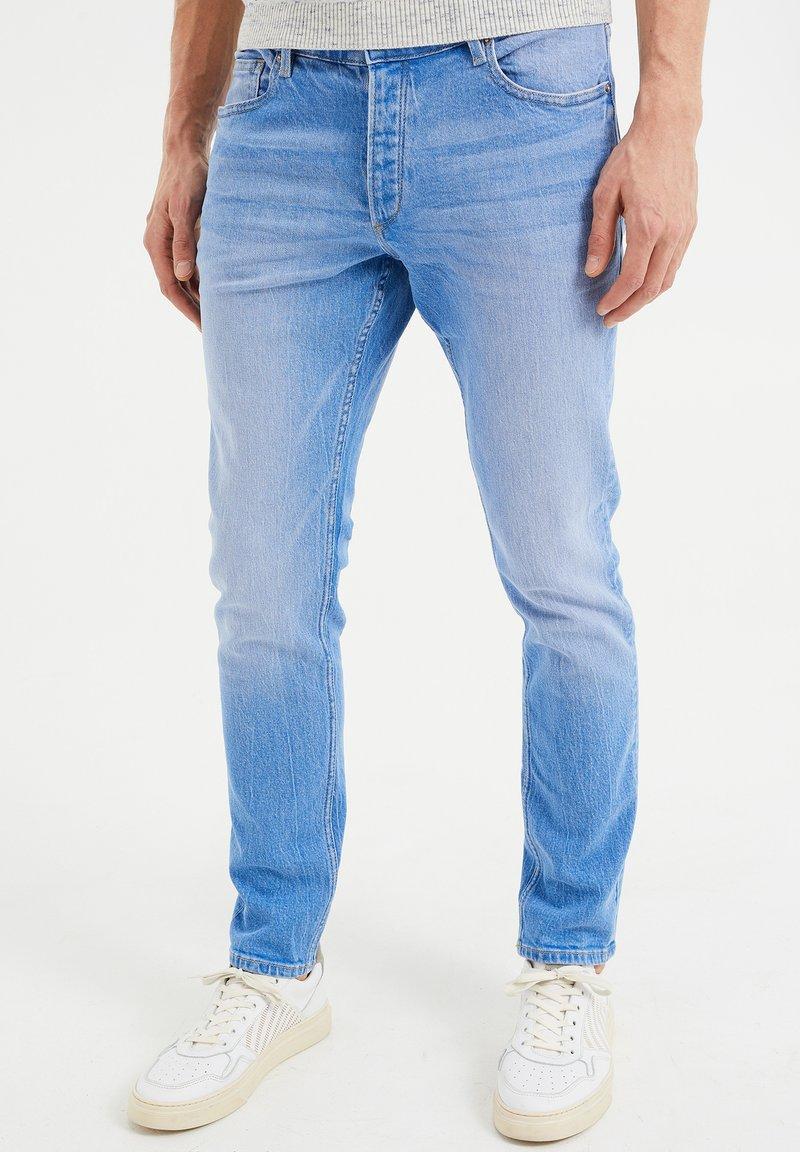 WE Fashion - COMFORT STRETCH - Slim fit jeans - blue