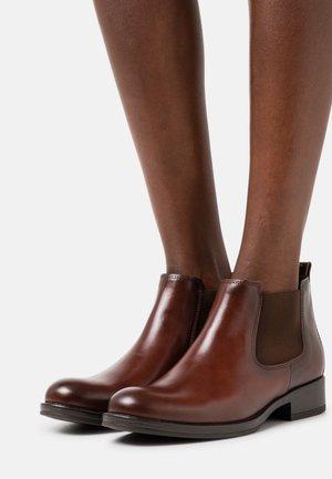 Korte laarzen - sattel
