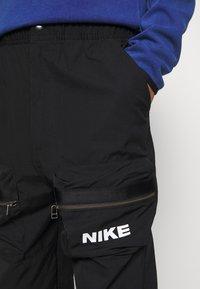 Nike Sportswear - CITY MADE PANT - Cargobukser - black/white - 4