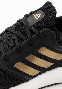 adidas Performance - ULTRABOOST 20 PRIMEKNIT RUNNING SHOES - Neutral running shoes - core black/gold metallic/solar red - 5