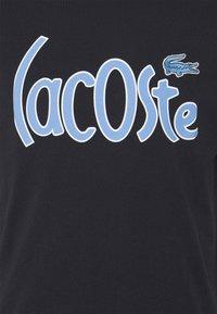 Lacoste - Print T-shirt - abimes - 5