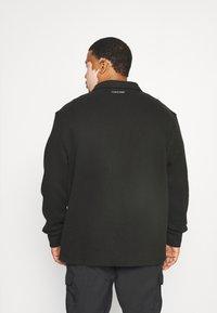 Calvin Klein - JACKET - Zip-up sweatshirt - black - 2