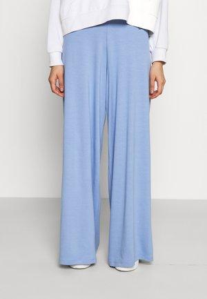 FLARE PANTS - Trousers - light blue