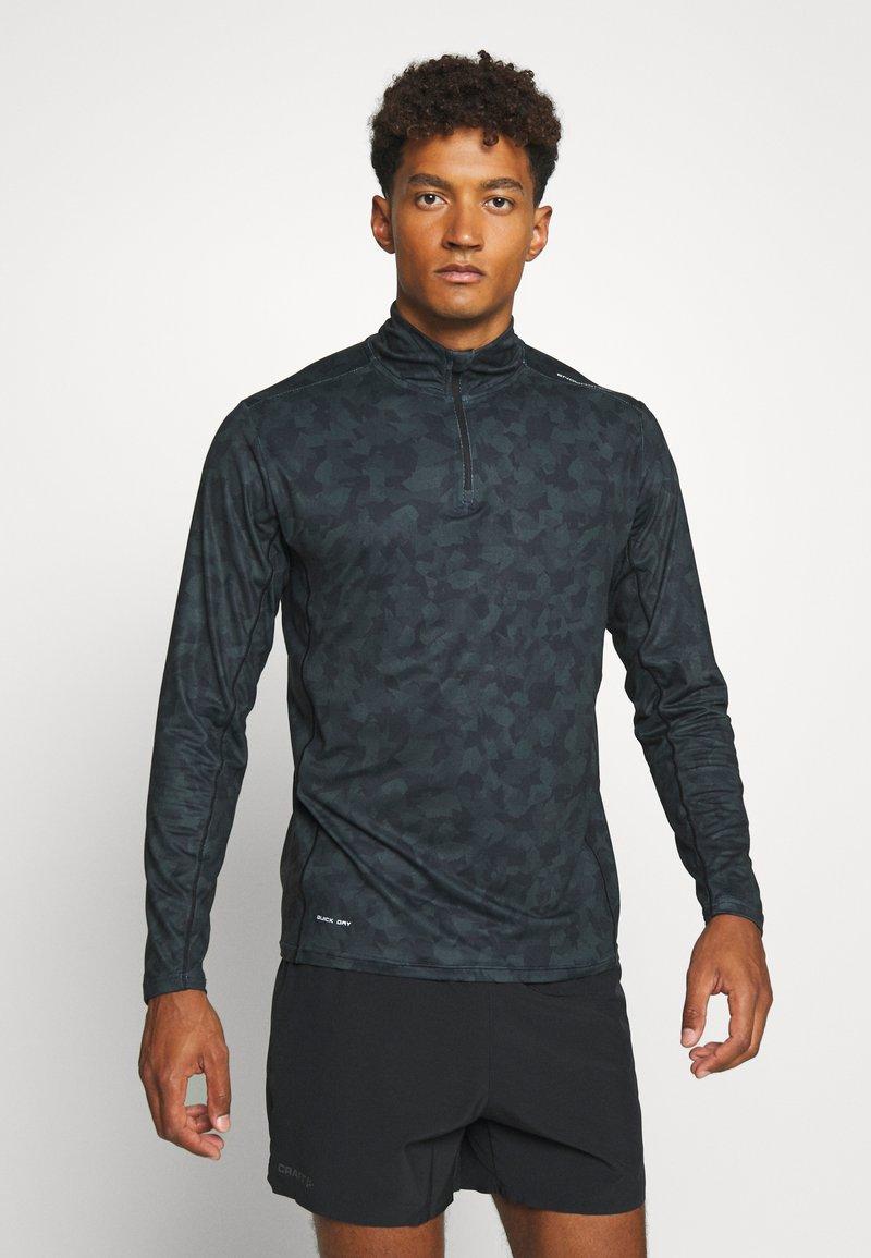 Endurance - ABBAS M PRINTED MIDLAYER - Camiseta de deporte - black print