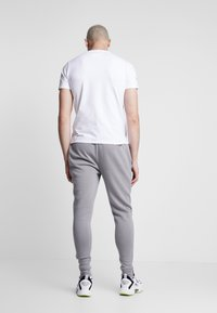 STEREOTYPE - Tracksuit bottoms - grey - 2