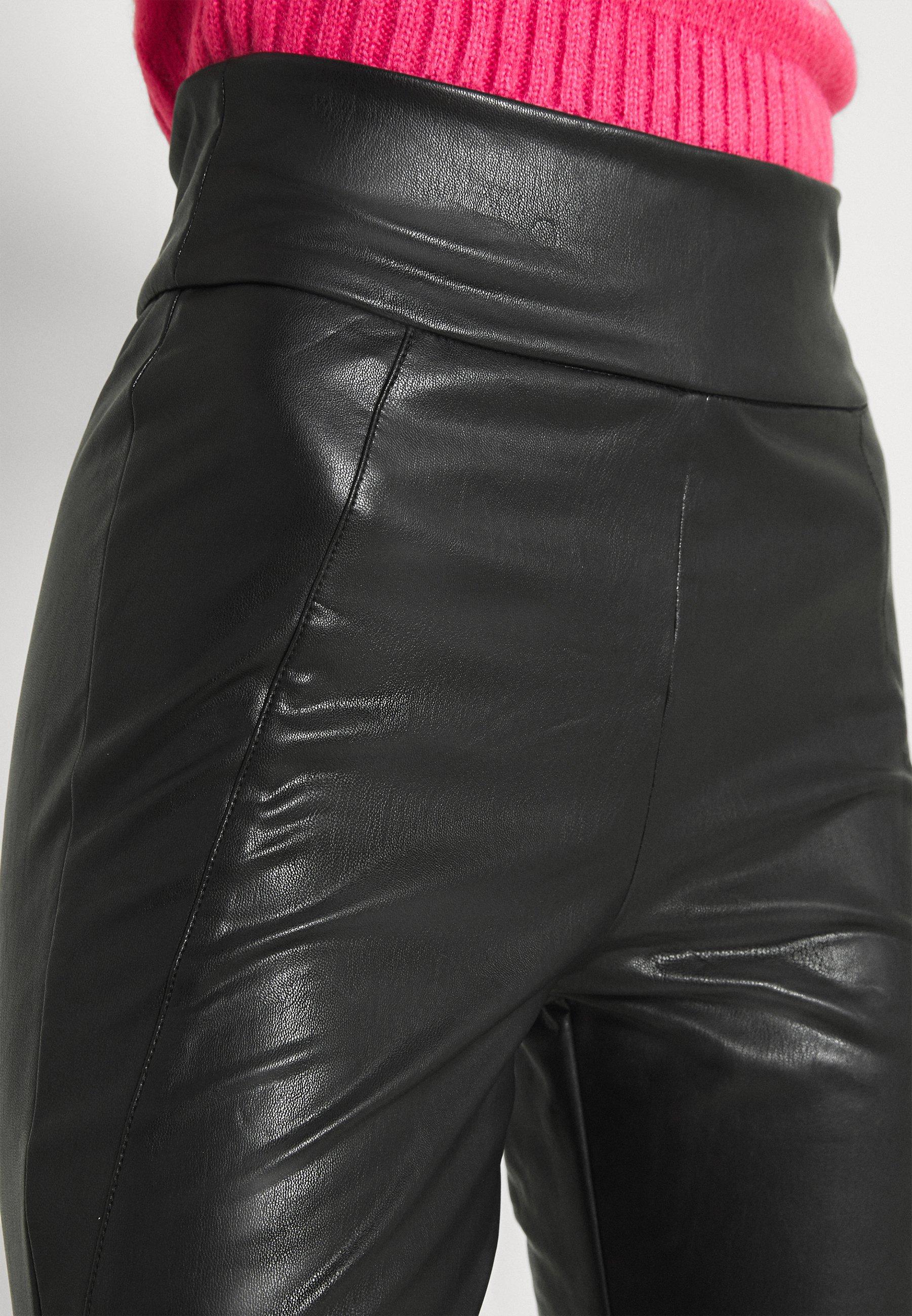 Women VINNIS COATED - Trousers