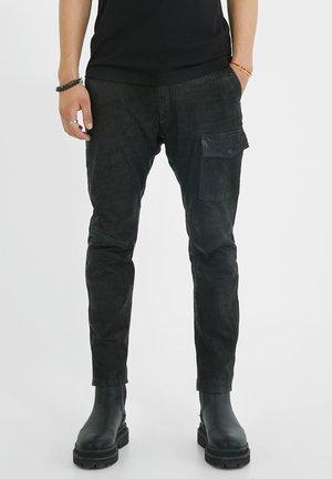 ARIS TAHARI - Leather trousers - black