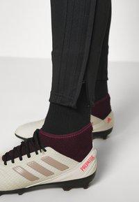 adidas Performance - TIRO - Tracksuit bottoms - black - 3