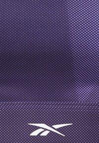 Reebok - STRAPPY BRA  - Light support sports bra - purple - 2