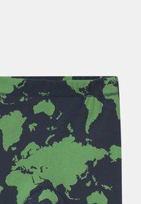 Molo - SEB UNISEX - Leggings - Trousers - green - 2