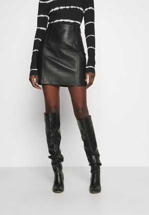 TAKE CARE - Leather skirt - black