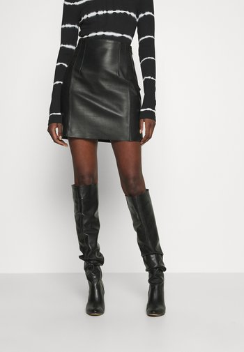 TAKE CARE - Leather skirt - black