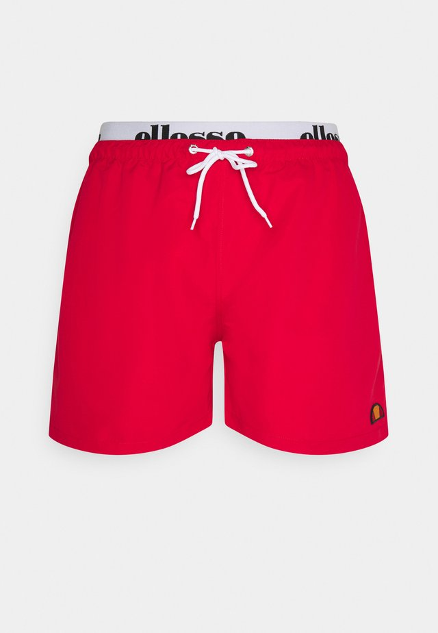 TEYNOR - Swimming shorts - red