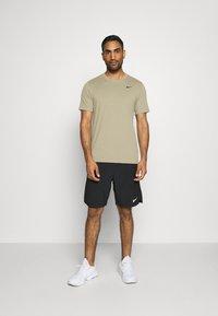 Nike Performance - DRY TEE CREW SOLID - Basic T-shirt - mystic stone/black - 1