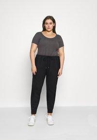 Nike Sportswear - W NSW AIR PANT  - Tracksuit bottoms - black - 1