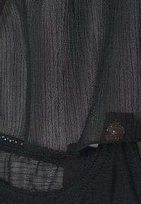 Coco de Mer - PENELOPE HALTER BRA - Underwired bra - black - 2