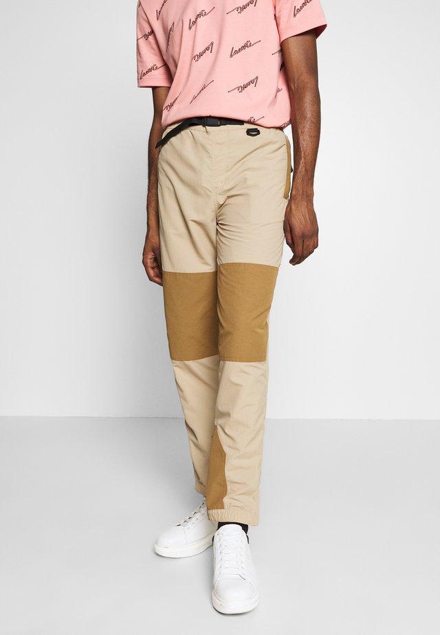 Spodnie treningowe - viennese/leafy