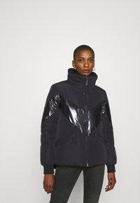 Guess - ORIETTA REVERSIBLE JACKET - Winter jacket - jet black - 0