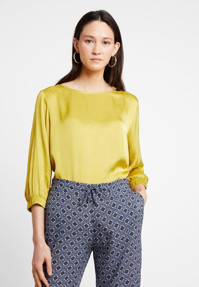 Blusa - golden yellow