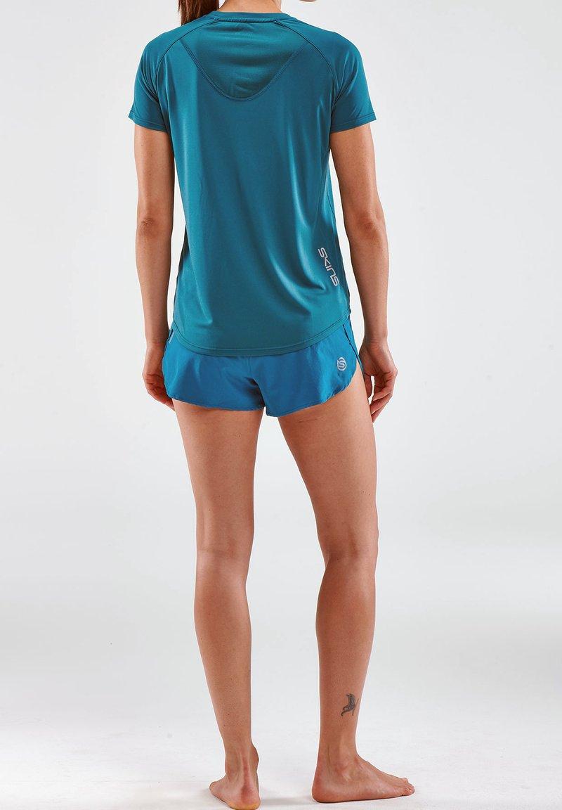 Skins - Print T-shirt - teal