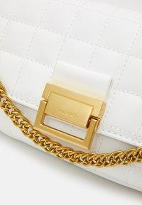 ALDO - OLEOSA - Handbag - off white/gold-coloured - 5