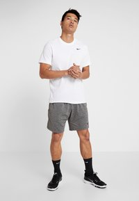 Nike Performance - DRY TEE CREW SOLID - Basic T-shirt - white/black - 1