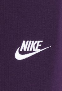 Nike Sportswear - CLUB - Tracksuit bottoms - grand purple/white