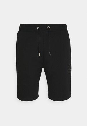 JASTER - Pantalon de survêtement - black