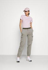 Nike Sportswear - PANT - Tracksuit bottoms - light army/cargo khaki - 1