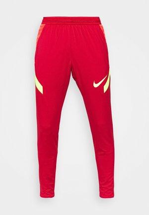 STRIKE PANT  - Tracksuit bottoms - gym red/bright crimson/volt