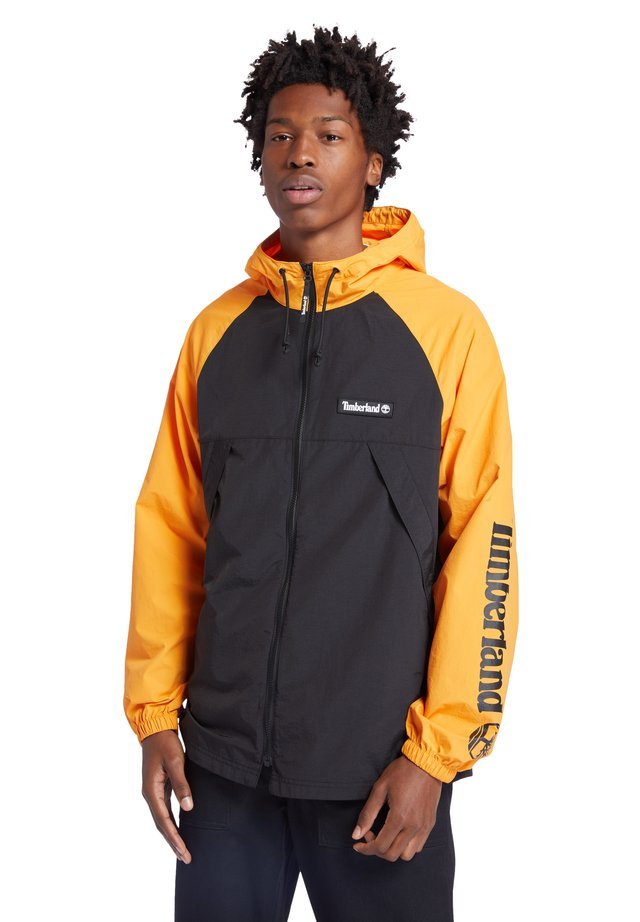 Windbreaker - dark cheddar/black