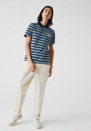 Polo - bleu marine / orange / bleu / beige / blanc