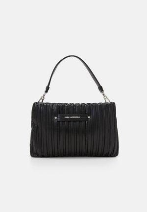 KUSHION - Handbag - black