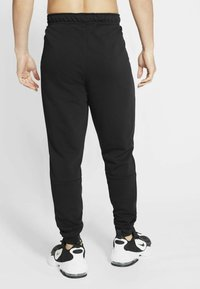 Nike Performance - PANT TAPER - Tracksuit bottoms - black/white - 2