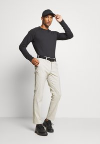 Peak Performance - PLAYER PANT - Trousers - dwell beige - 1