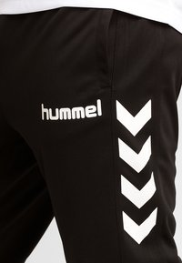 Hummel - CORE - Pantalon de survêtement - black - 3
