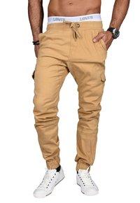 DESIGNER - Cargo trousers - beige
