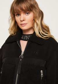 Calvin Klein Jeans - POLAR SHORT JACKET - Winter jacket - black - 3