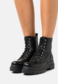 Call it Spring - VEGAN XENIA - Platform ankle boots - black - 0