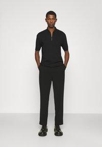 HUGO - DONHAM - Polo shirt - black - 1